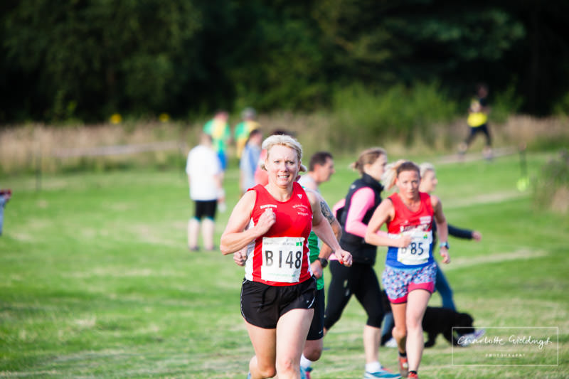 whitchurch whippet female club runner sprinting towards the finishing line