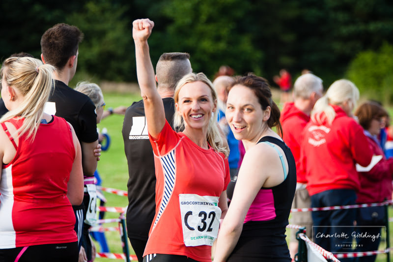 enthusiastic female punching the air and ready to run her lap of the course - shropshire running event