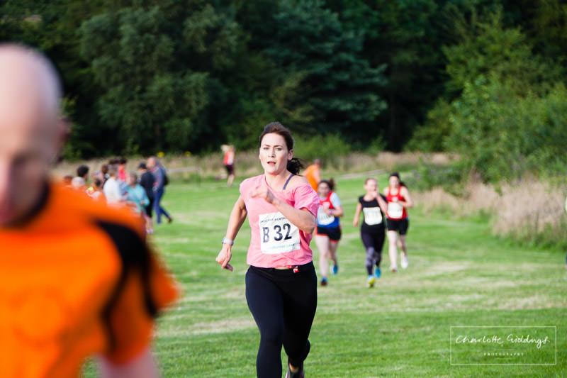 female runner determined and pushing herself towards the finishing line - shropshire photographer