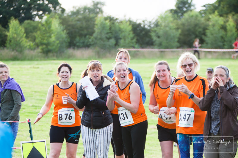female club runners cheering on runners coming in to the finishing line -dearnford lake relay 2016