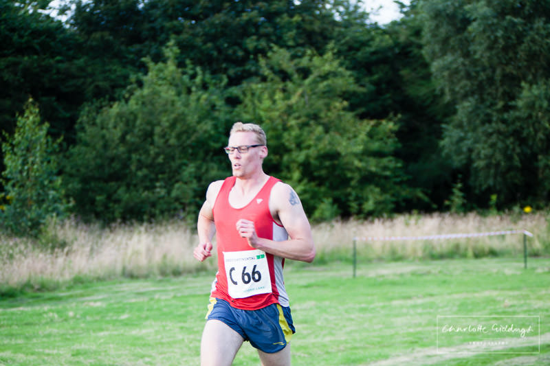 male runner pushing himself to finish the running race at dearford lake event
