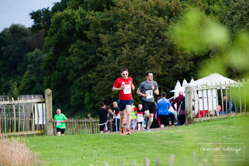 tired runners coming in to finish their lap at running event whitchurch