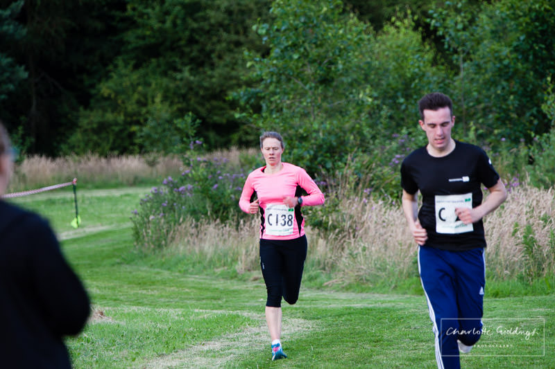female runner concentrating coming up towards to finishing line at the shropshire running event