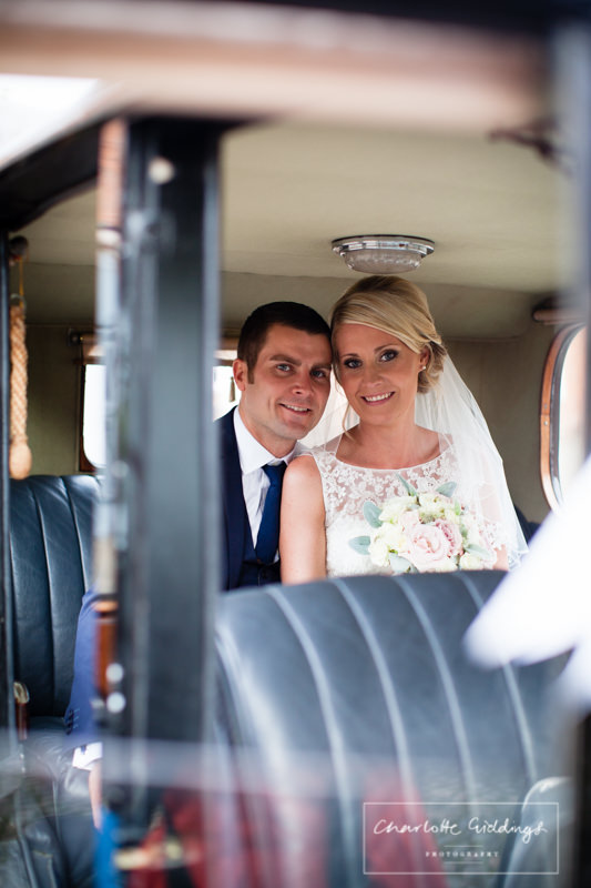 bride and groom in combermere abbey crosby car