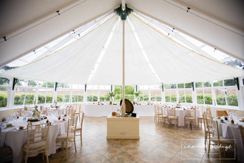 glasshouse set up for speeches and wedding breakfast