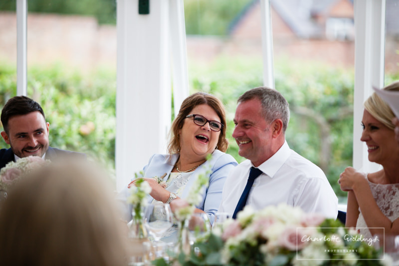 mother of the groom laughing out loud