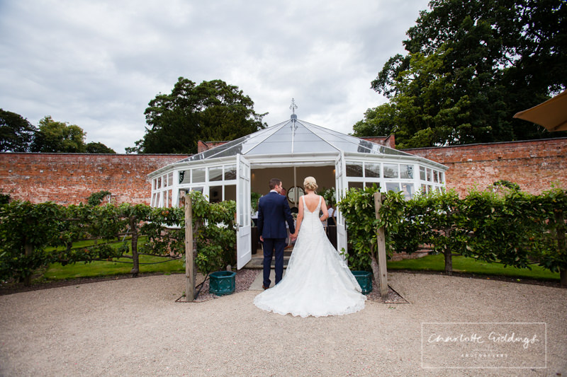 bride and groom entering the glasshouse combermere abbey