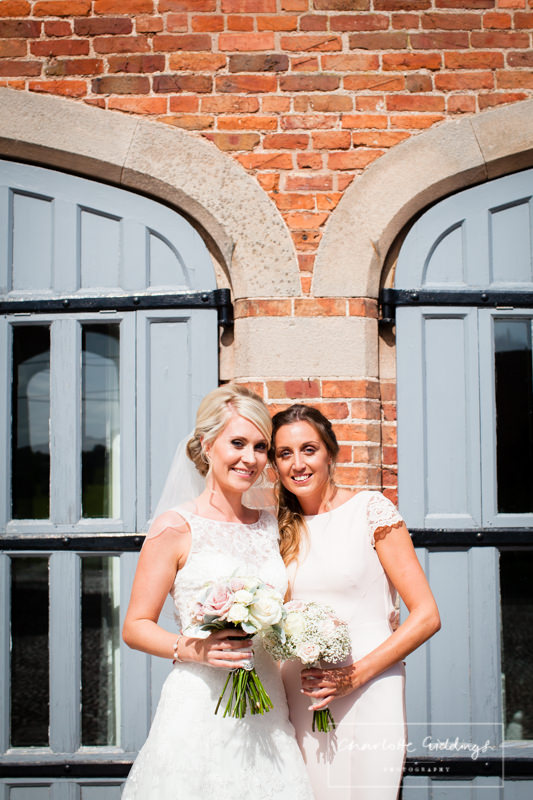 bride with bridesmaid at combermere abbey cottages