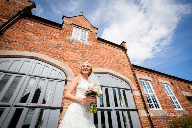 bride portrait outside combermere abbey cottages