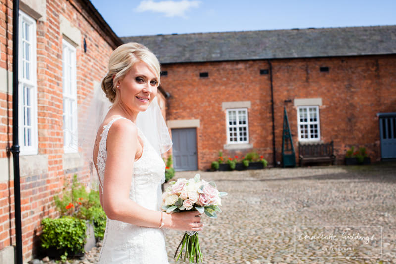 bride outside beckett cottage combermere abbey