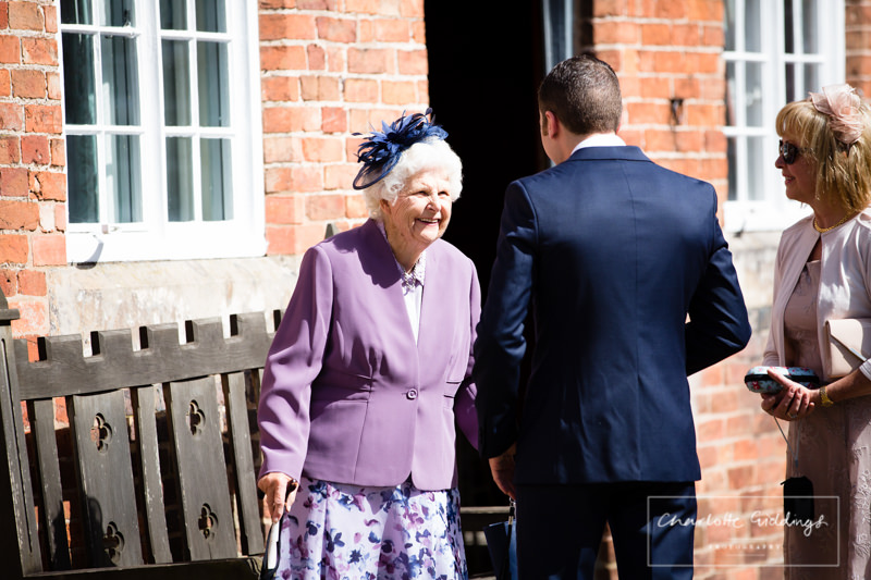groom seeing his nanna on his wedding day