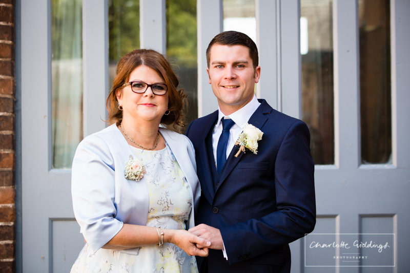 groom with his mum on his wedding day