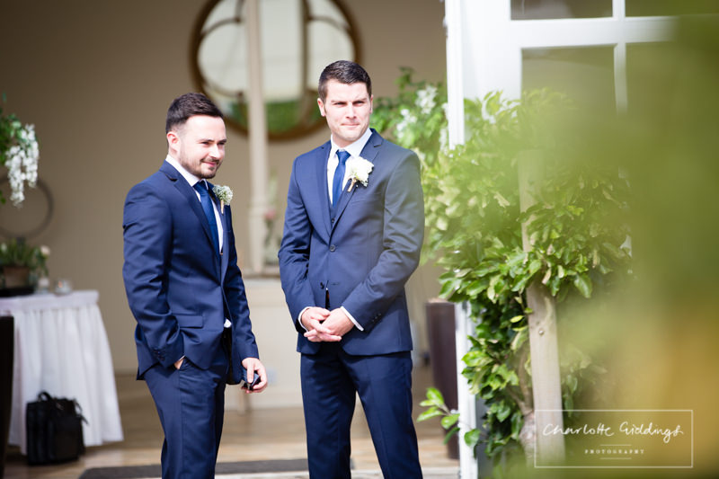 groom and best man waiting for guests to arrive