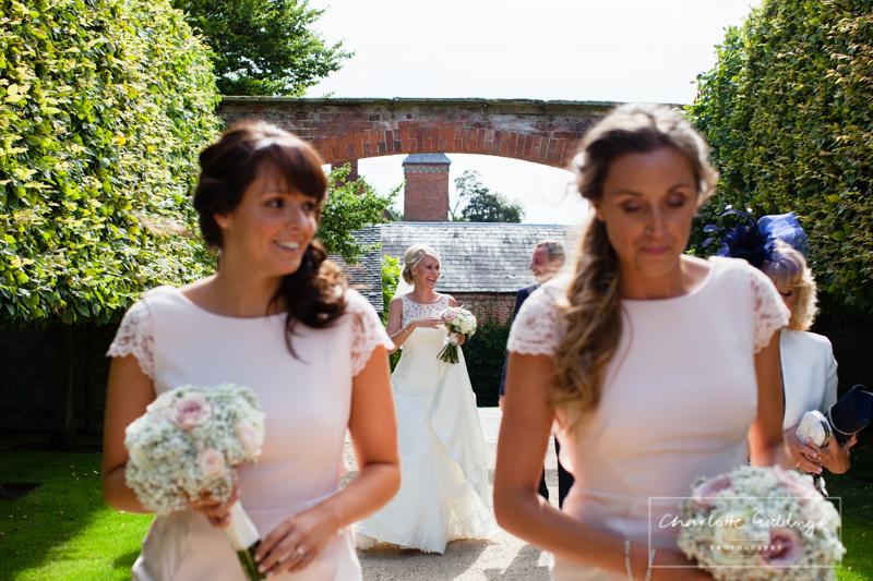 bride walking to glasshouse ceremony