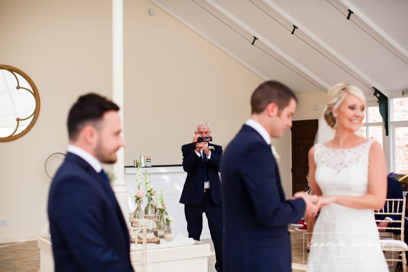 grandad videoing the wedding cermony