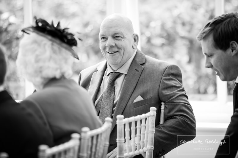 father of the groom candid photo