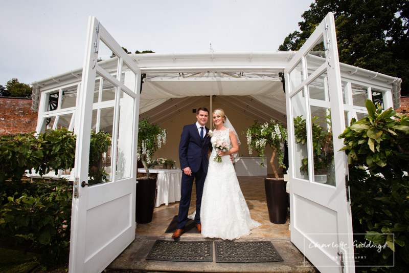 bride and groom outside the glasshouse