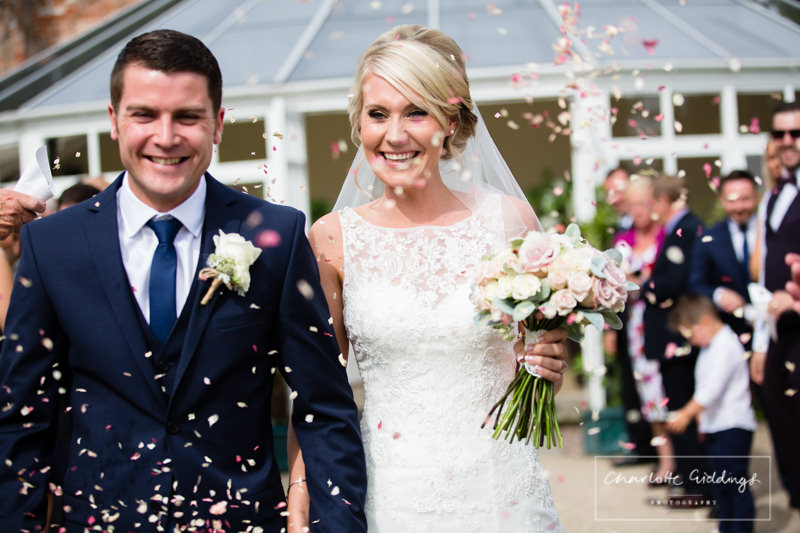 very hapy bride and groom confetti shot