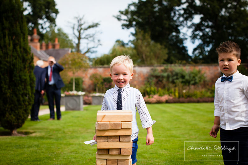 child about to push jenga tower over