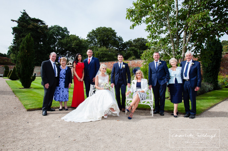 brides extended family at combermere abbey near the pavillion