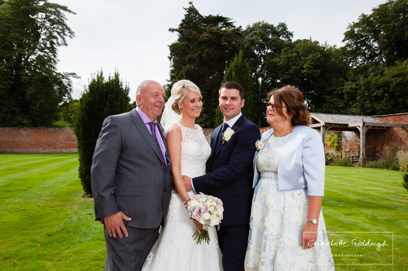 groom, bride and mum and dad at wedding