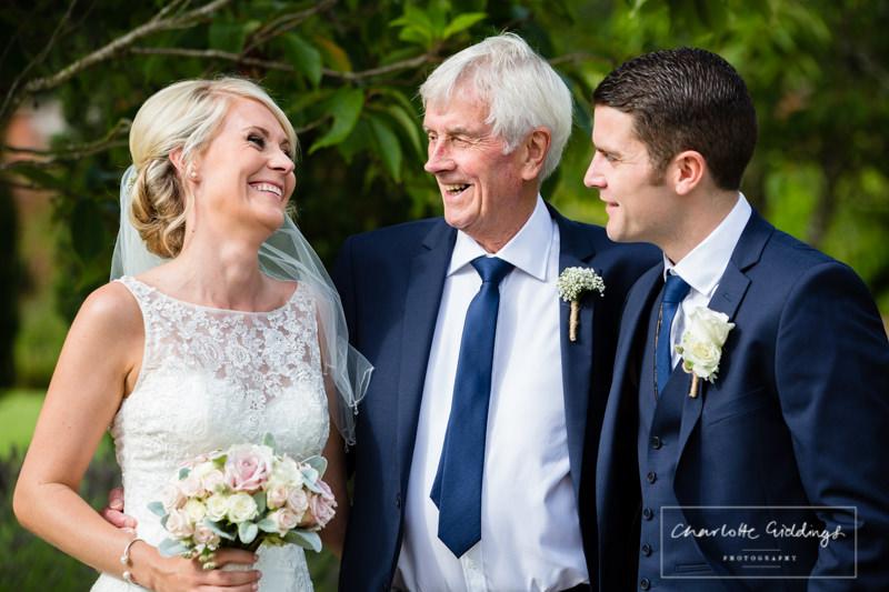 bride groom and grandad special photo eye contact