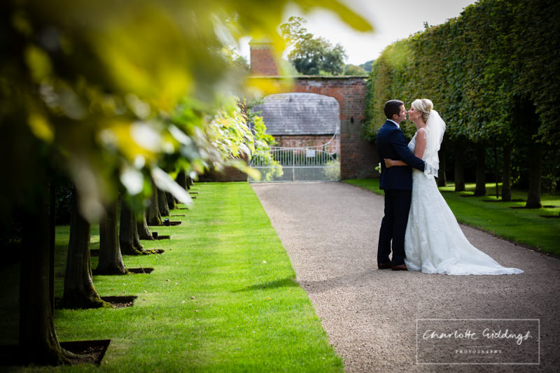 bride and groom having a moment at combermere abbey