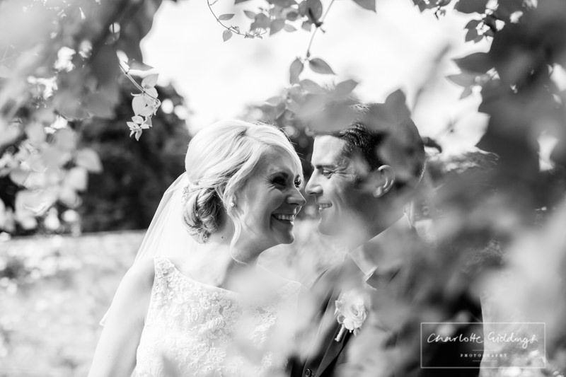 bride and groom having a giggle together