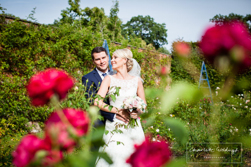 bride and groom in the gardens at combermere abbey