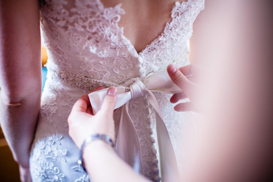 finishing touch on wedding dress