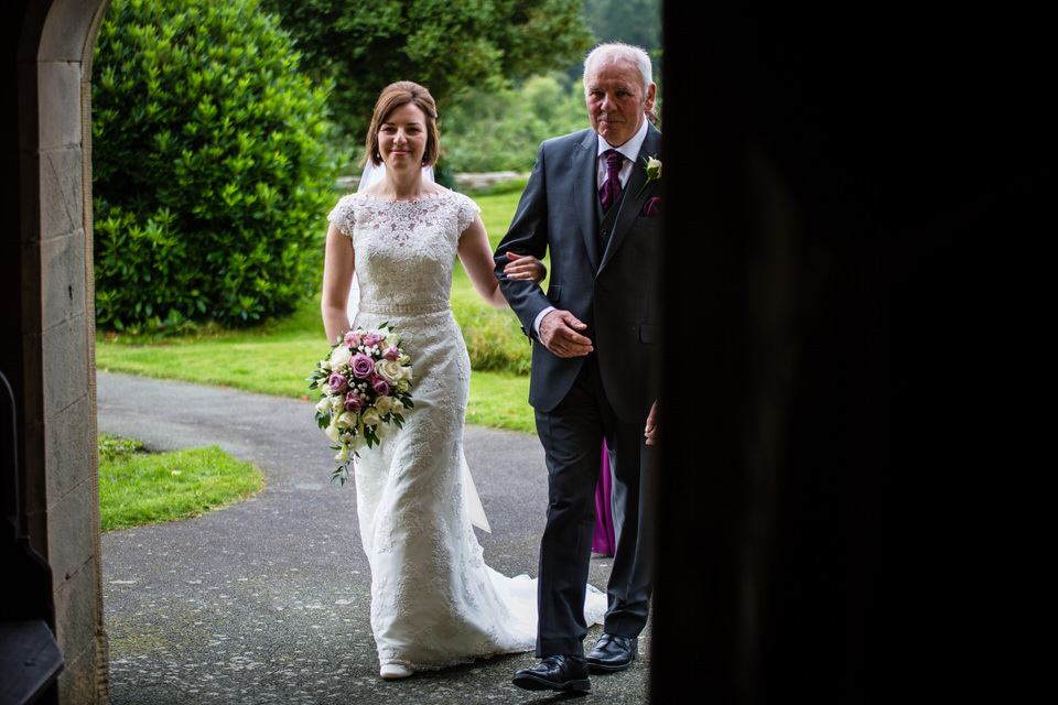 bride arriving at st. llwchaiarns church
