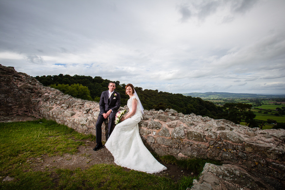 bride and groom at montgomery castle mid wales