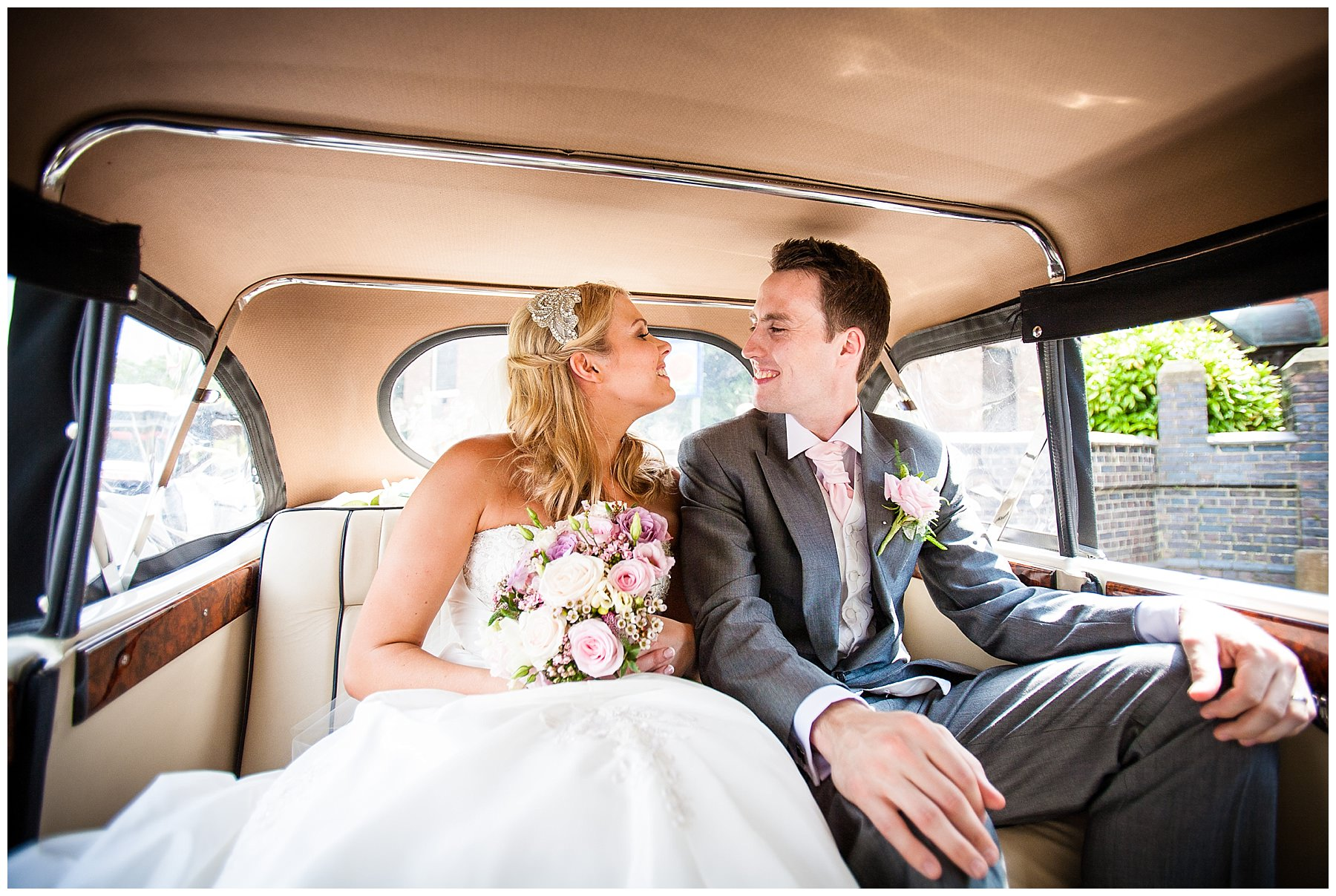 Just Married Bride and Groom in wedding car at st. annes church, wistaston