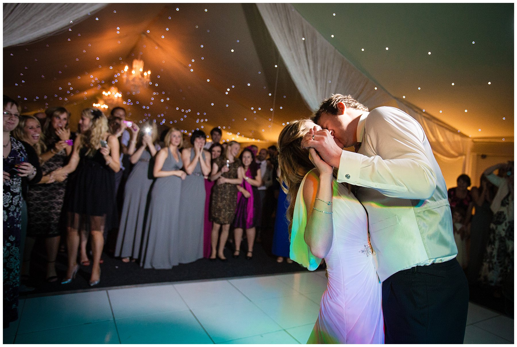 bride and groom kiss during their first dance at their shropshire wedding at combermere abbey in the pavillion