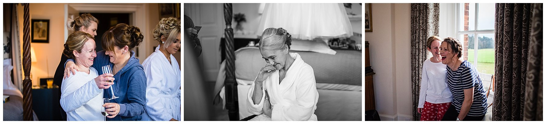 mother of the bride giggling to herself in the bridal suite amongst the chaos