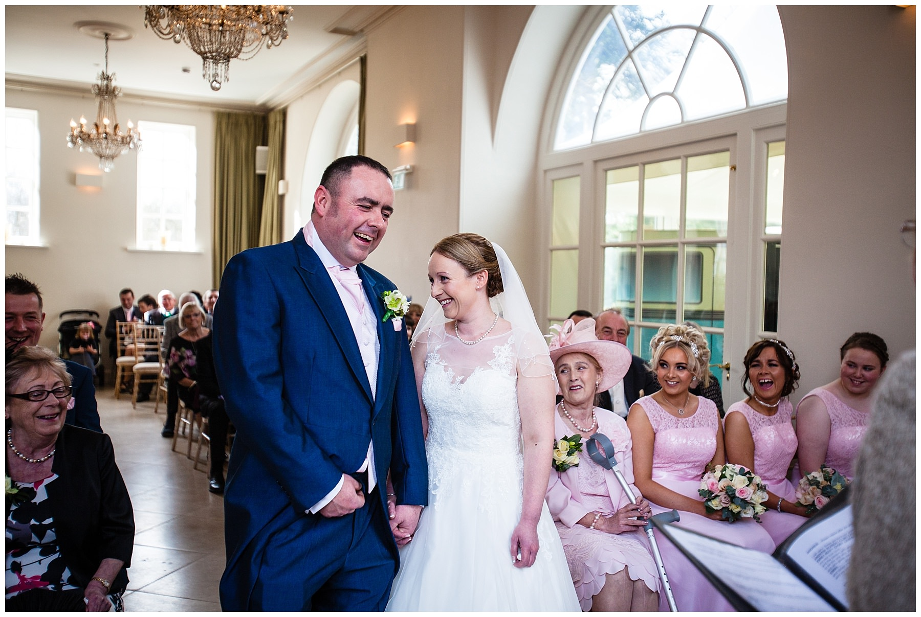 bride and groom laughing out loud during their iscoyd park ceremony at their winter wedding