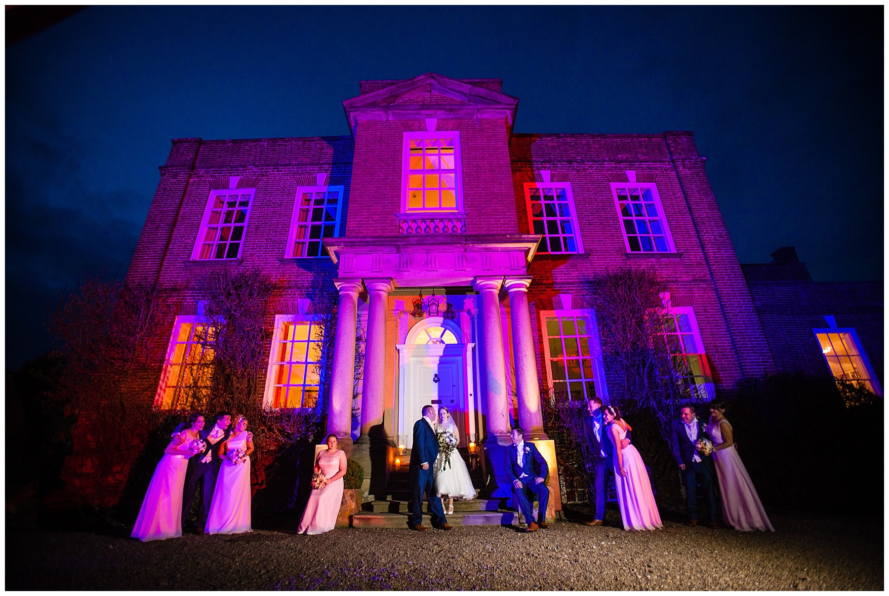 bridal party photo with iscoyd park illuminated with pink lighting - charlotte giddings photography