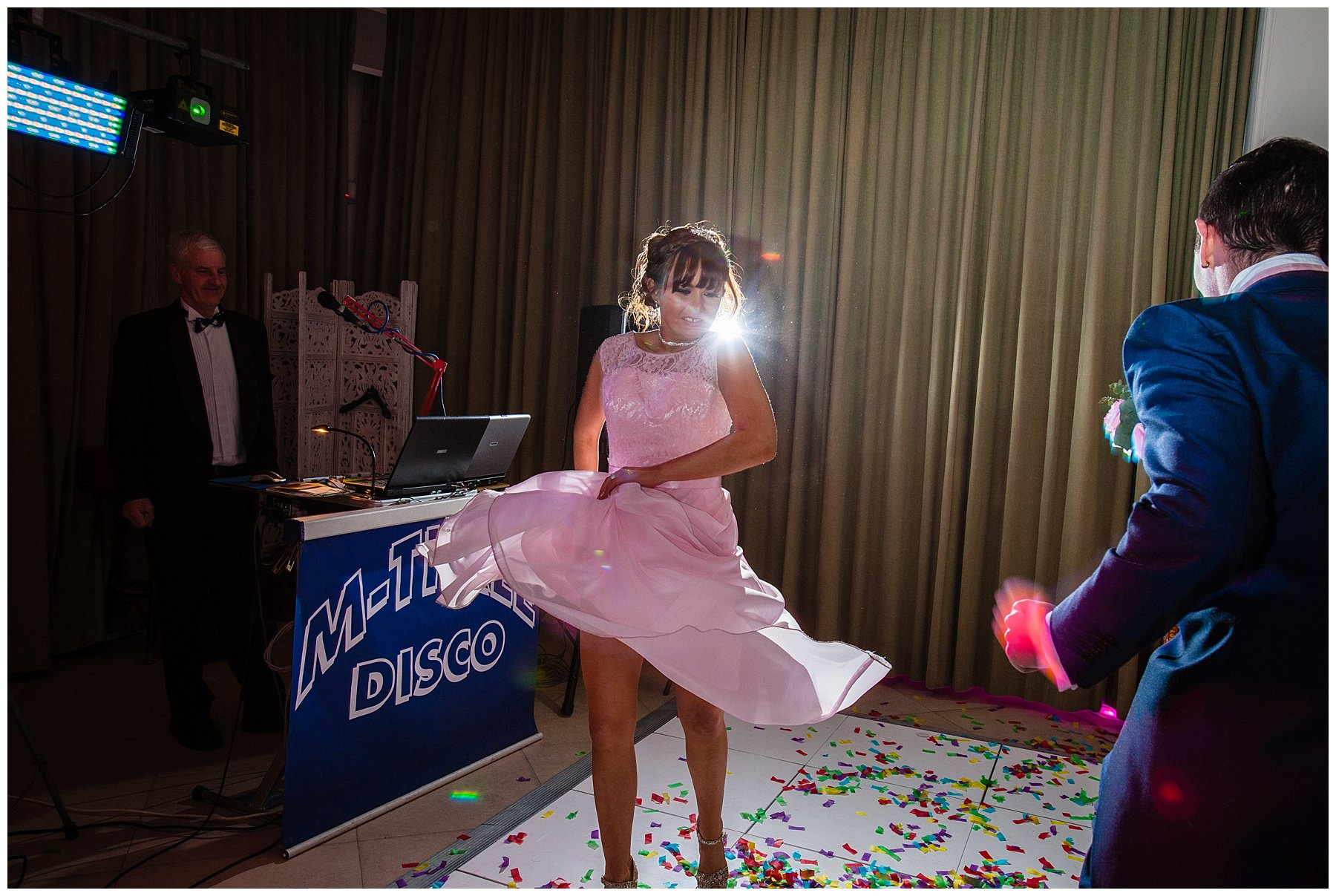 action shot of bridesmaid swinging her skirt while dancing at iscoyd park wedding - shropshire photographer