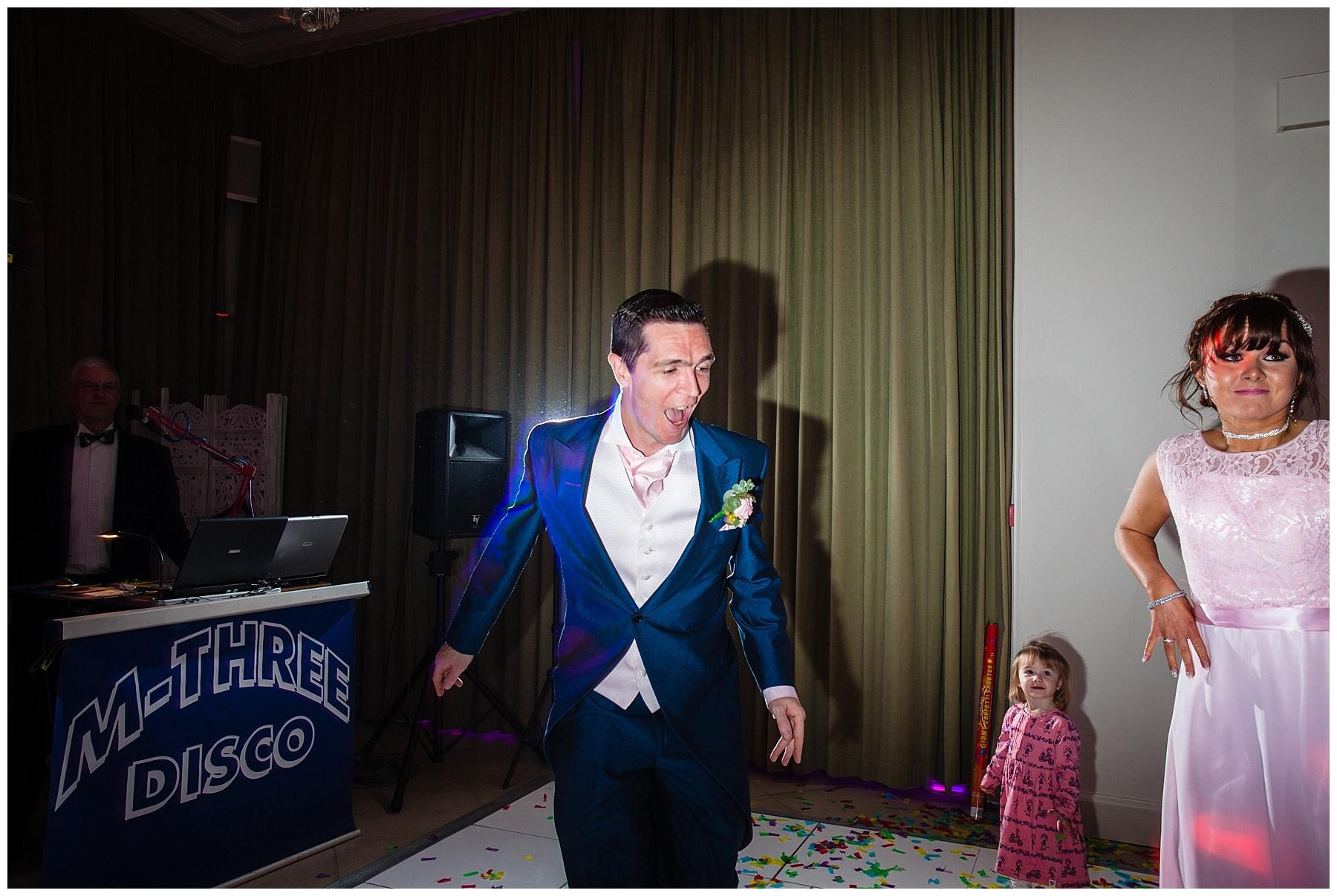 best man dancing at iscoyd park wedding - shropshire wedding photographer