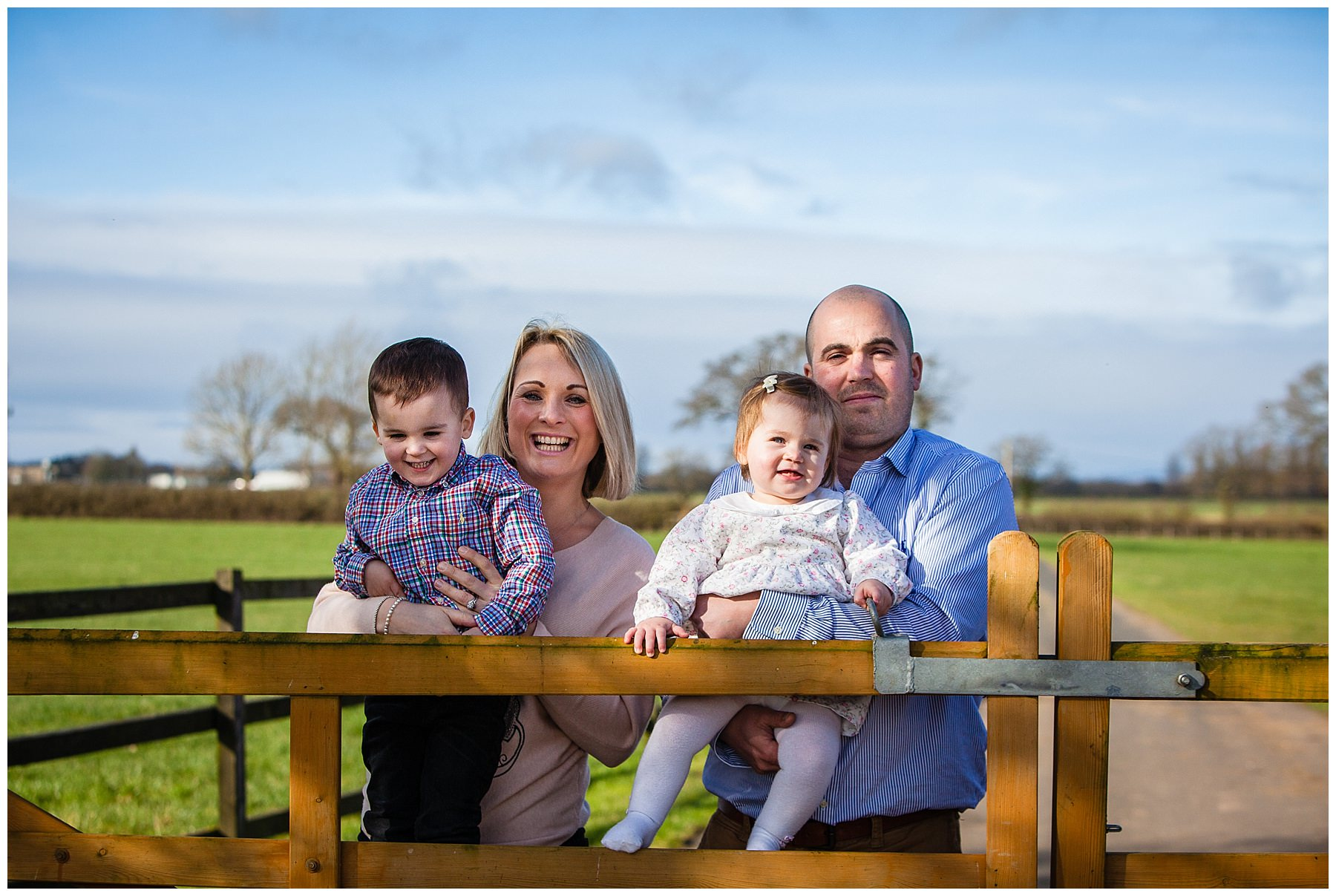 family photo by cheshire farm gate in february blue sky - charlotte giddings photography