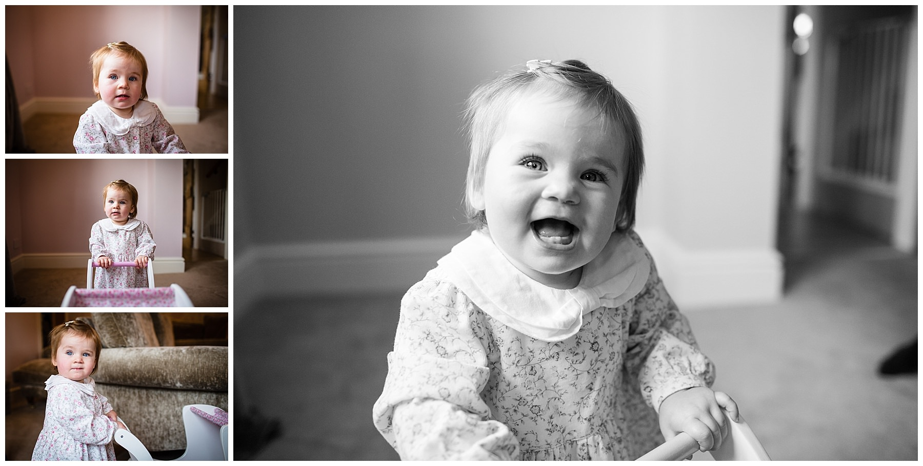 black and white photo of one year old girl holding a pram smiling