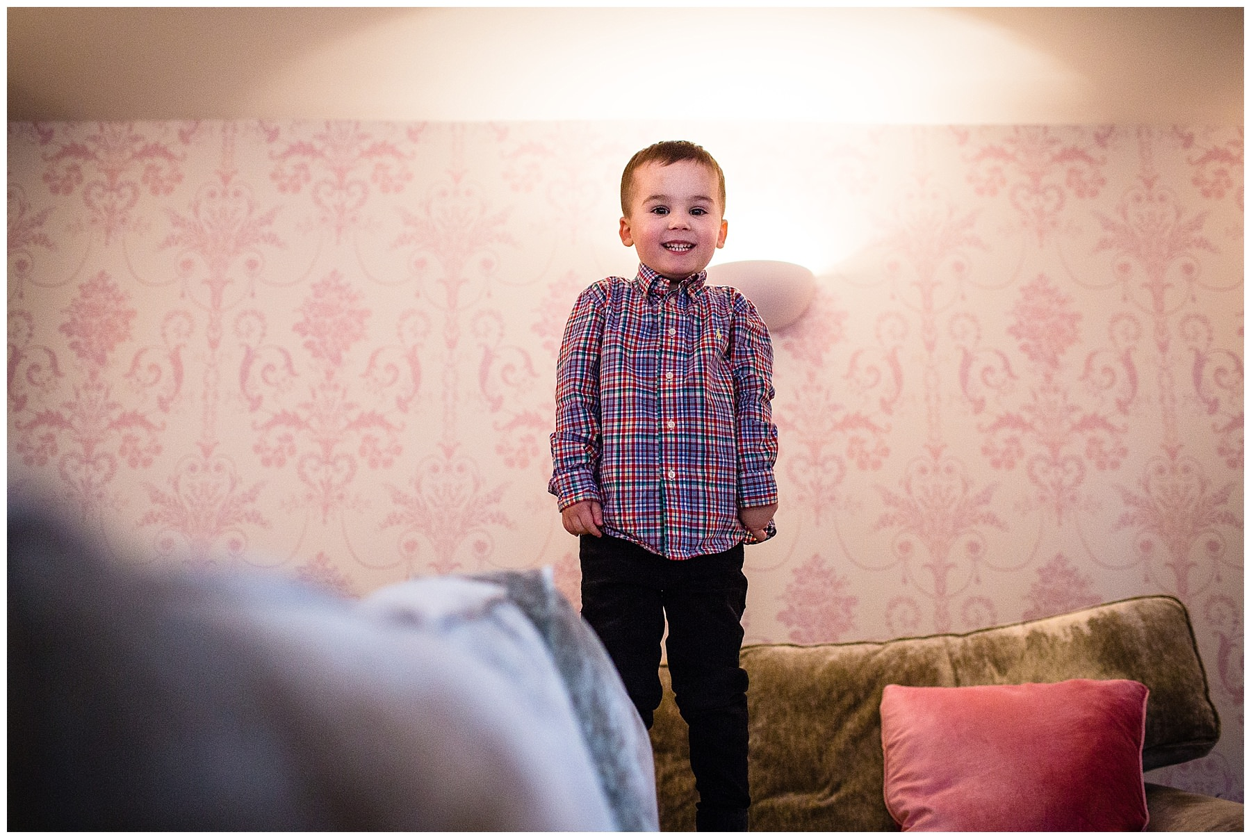 little boy standing on sofa looking angelic - cheshire family photographer