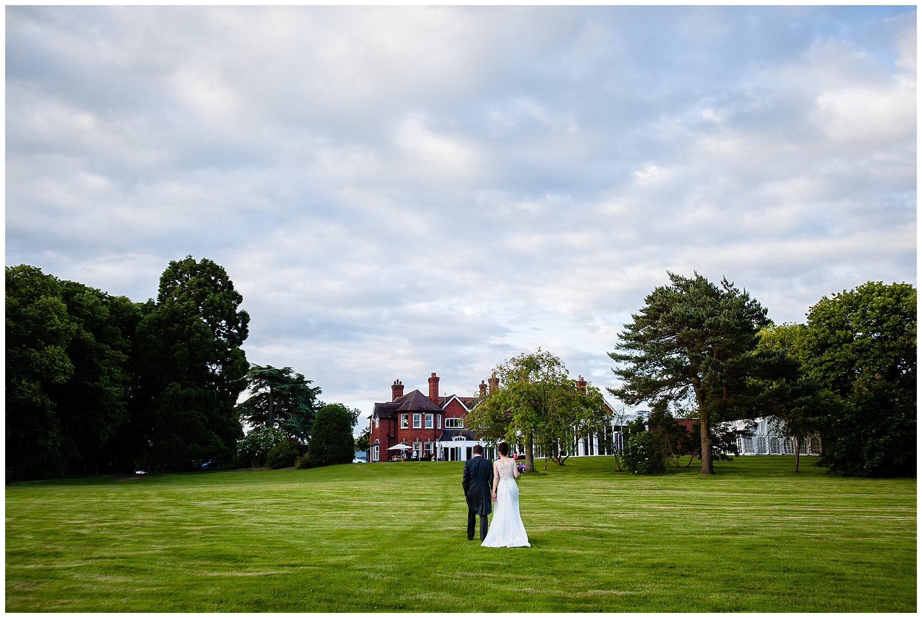 bride and groom walking towards the tern hill hall hotel - charlotte giddings photography