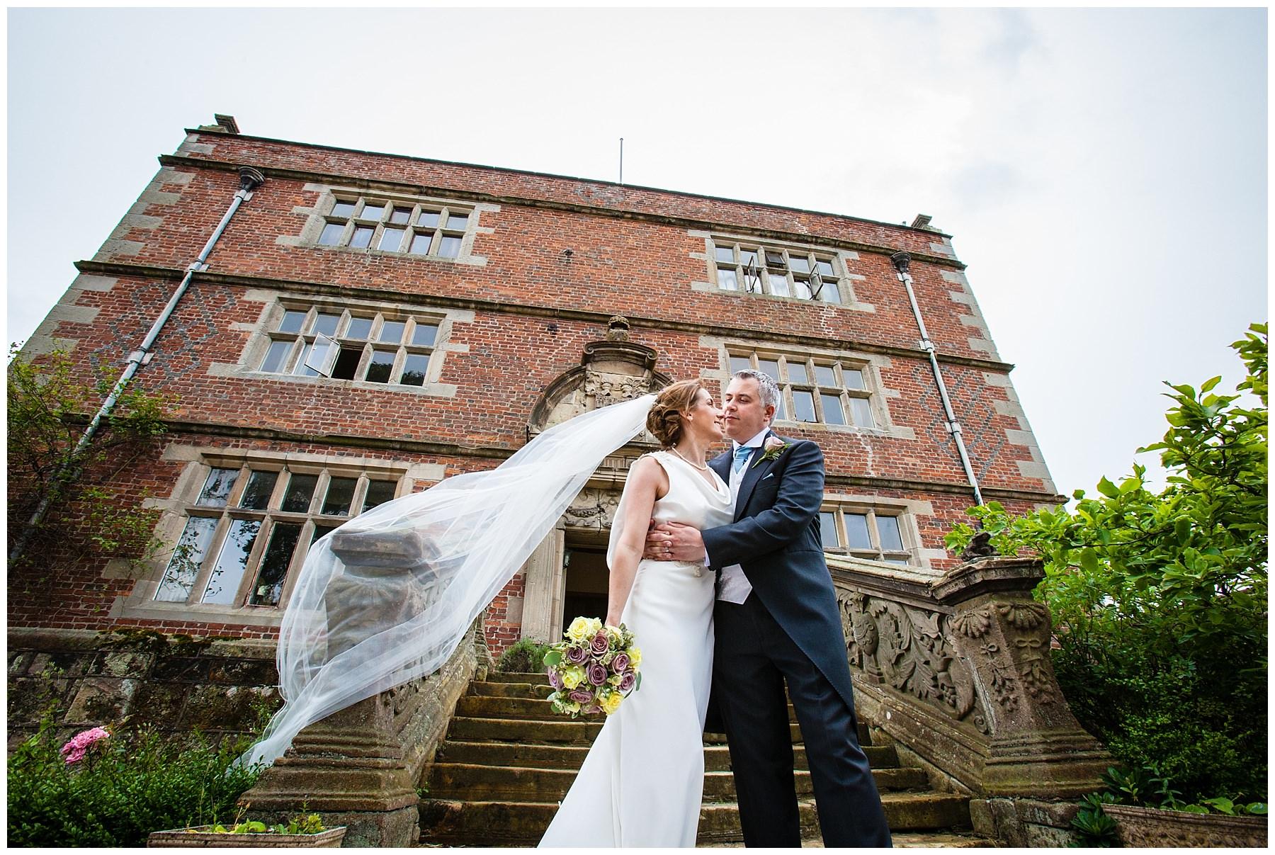 bride and groom in full width of soulton hall - best wedding venue shropshire