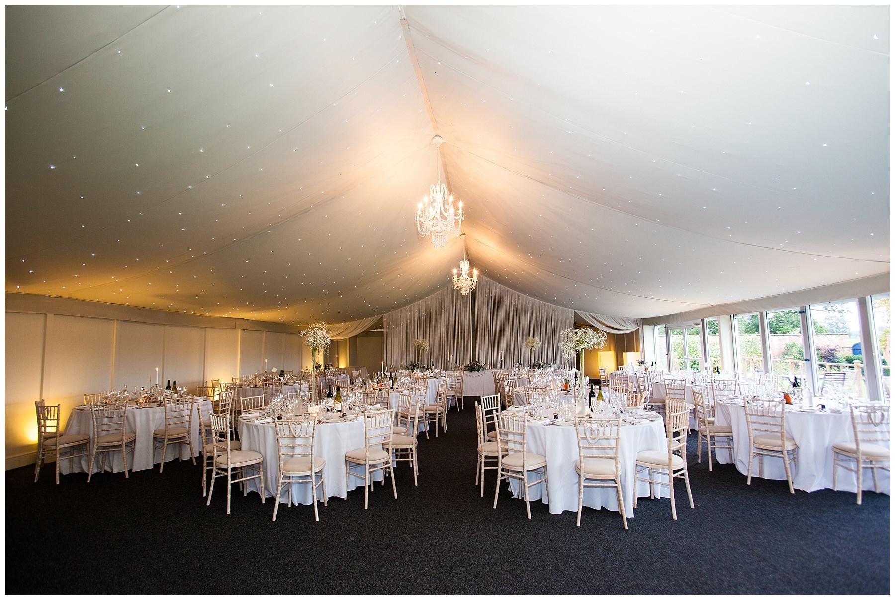 Combermere Abbey Pavillion set up for wedding breakfast - charlotte giddings photography