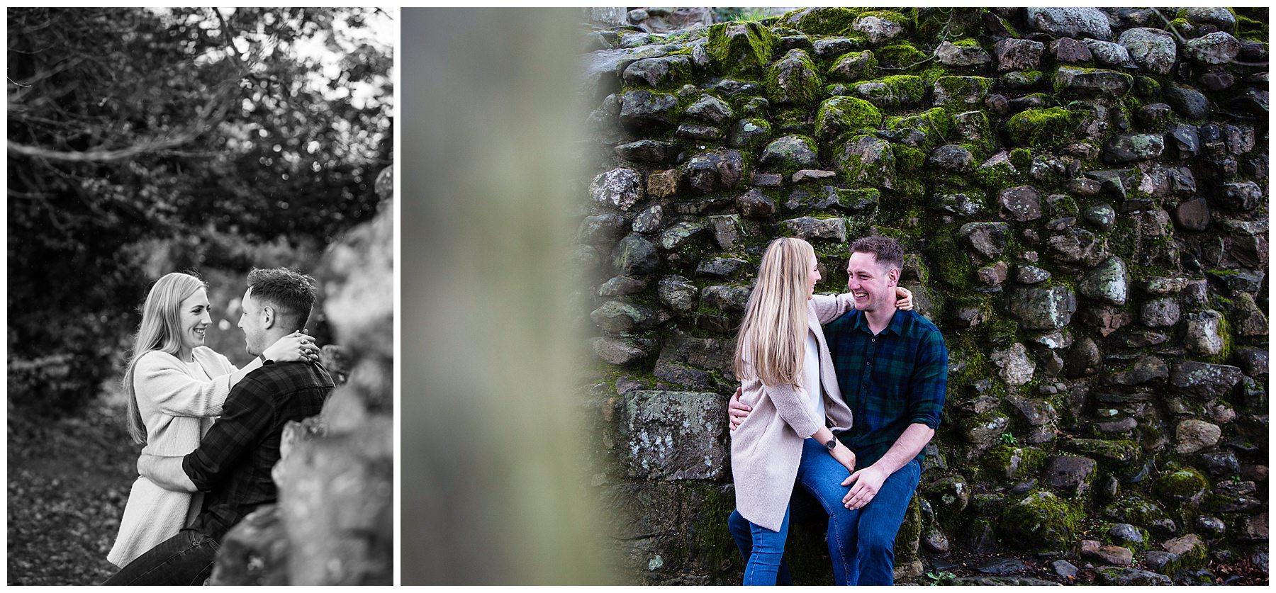 sneak peek view of couple sat on castle ruinsand having a moment - shropshire engagement shoot whittington castle