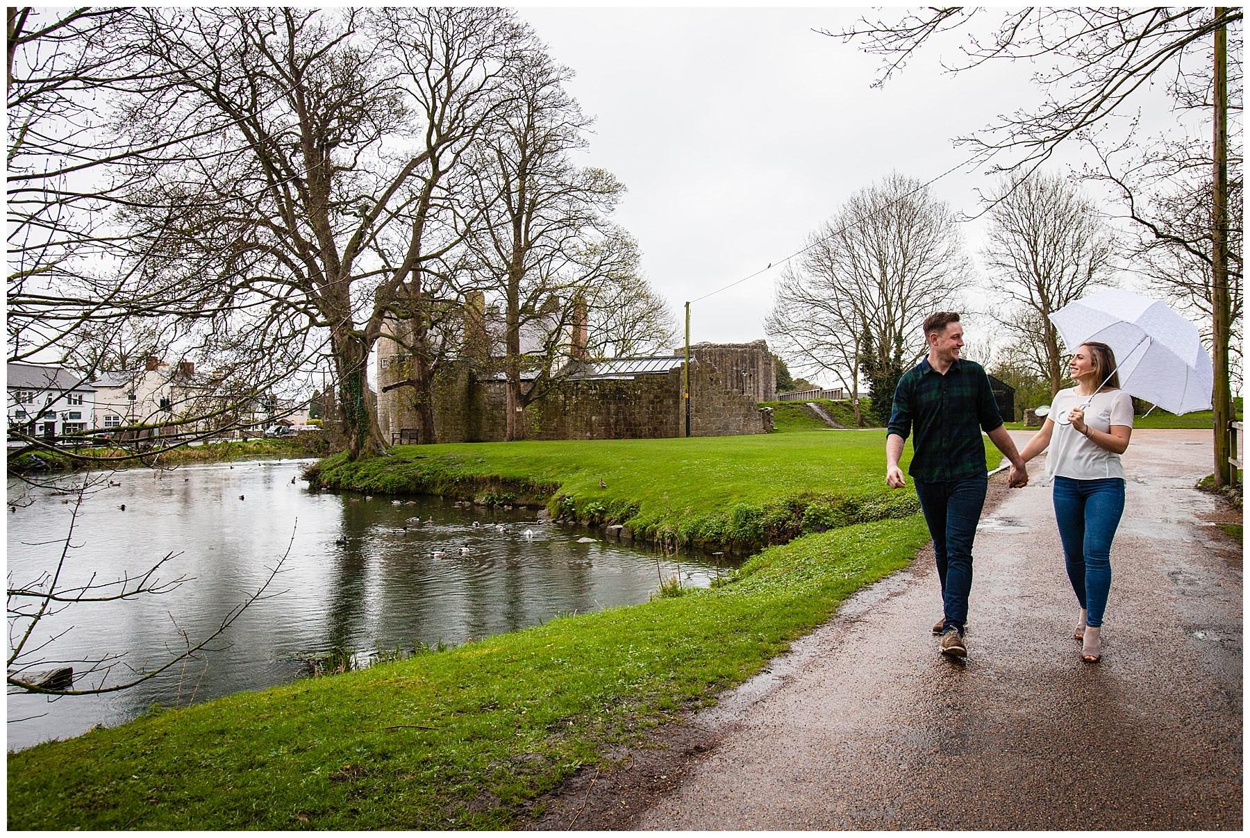 couple walking along the pathway at shropshire venue whittington castle - shropshire photographer