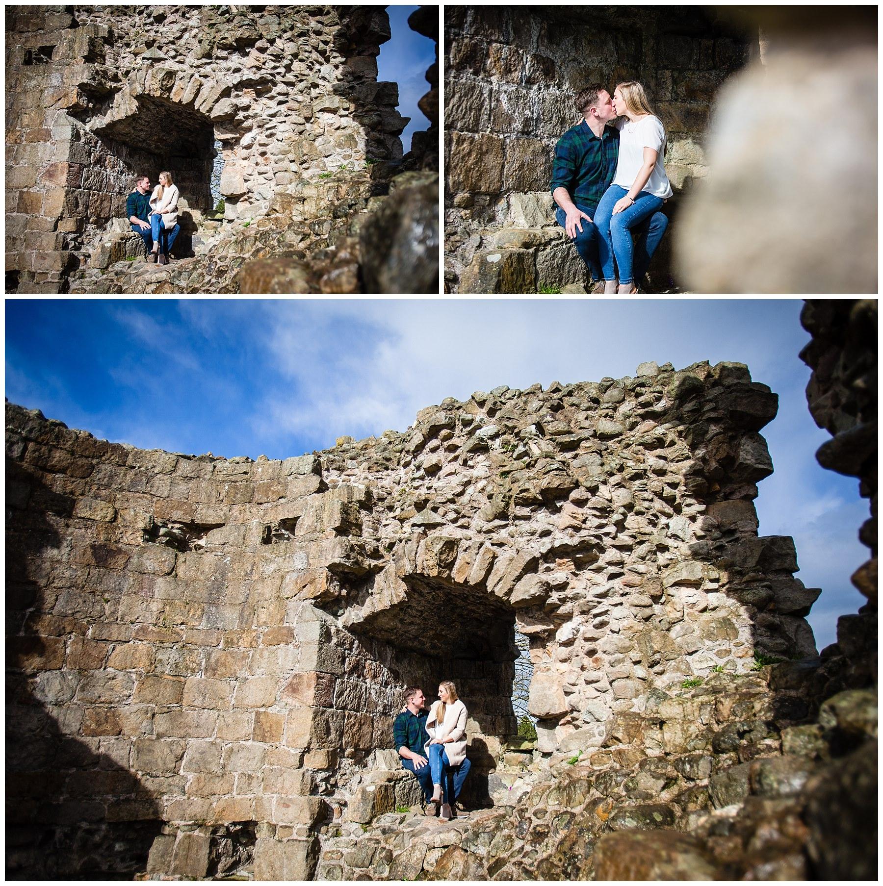 couple sat amongst castle ruins at whittington castle shropshire