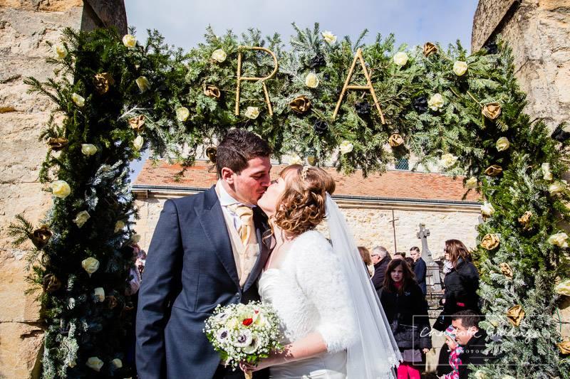 bride and groom kissing under flower arch - shropshire wedding photographer FAQ's