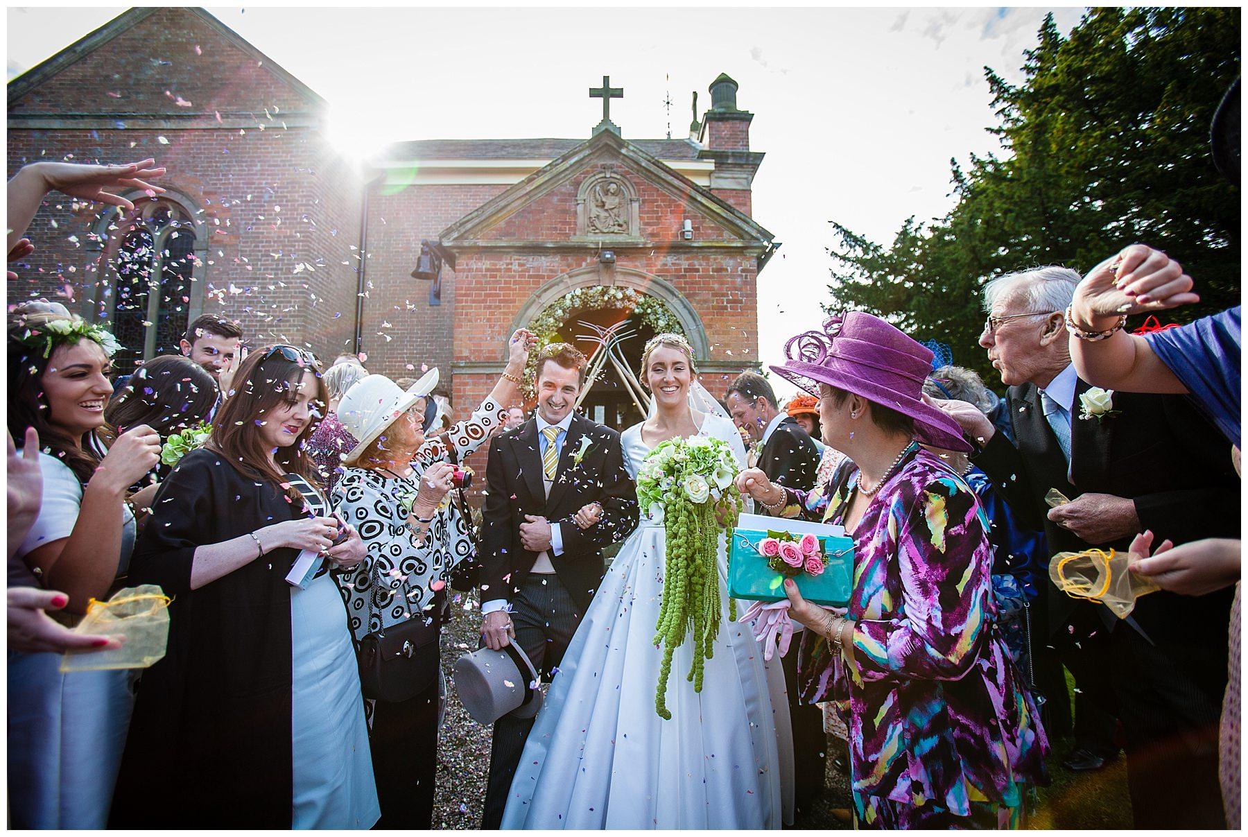 confetti throw outside burleydam church, shropshire wedding photographer